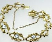 14K Gold Bracelet with Princess Cut Blue Stones