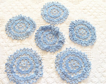 Light blue doillies made in the 1920's in Czechoslovakia.QTY: 6. Handmade by grandmother and great gran.