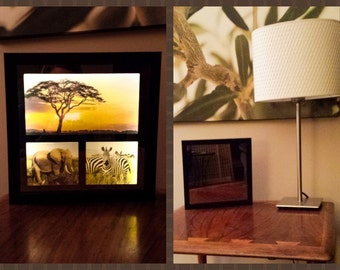 Framed shadow box mirror transforms to a backlit photo. Lighted Reflections are one of a kind products!