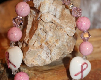 Handmade beaded breast cancer awareness bracelet made with pink riverstone and crystal beads.