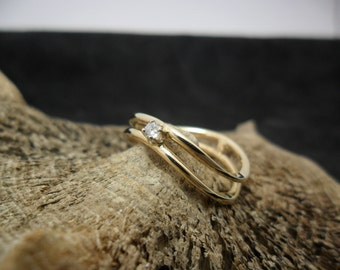 14 K yellow gold with diamond ring