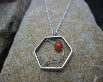 Pendant in sterling silver with a 4.5 mm carnelian