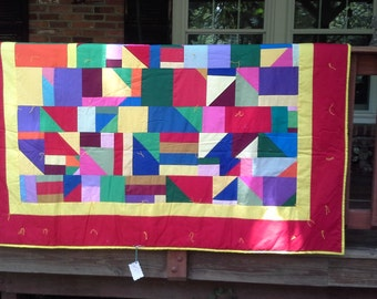 Packed with color, this full sized quilt will brighten any bedroom!
