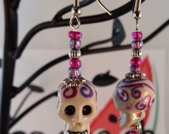 Detailed hand painted Day of the Dead Halloween skull earrings in two shades of purple and a touch of silver/CB-2PRPW001