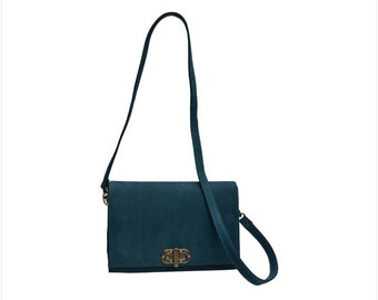 Hand made luxury nubuck leather muli-way clutch. Closes with turn lock front. Zipper pocket inside. Strap detachable.