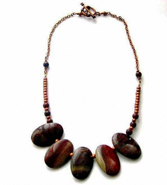 https://www.etsy.com/ie/listing/192562958/reserved-brown-stone-necklace-red-and?ref=shop_home_active_1