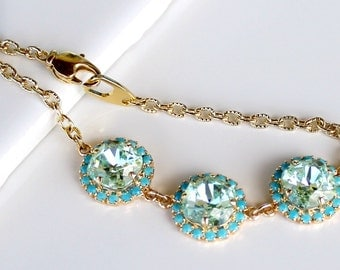 Light Green Swarovski Squares Surrounded with Turquoise Halo Crystals on a Gold Link Chain Bracelet