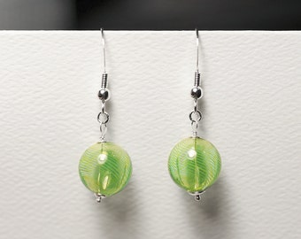 Go green with these delicious little lemon lime striped, hollow glass globe earrings