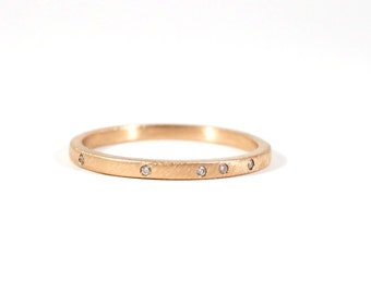 Teeny Diamond Specked Wedding Band in 14k Rose Gold