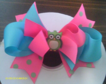 a layered bow with cute owl center available on barette or alligator clippie