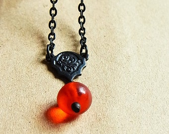Dark Antiqued Brass Necklace // Blood Orange Fulani Glass Bead // Vintage African Glass Bead // Ornate Flower Connector