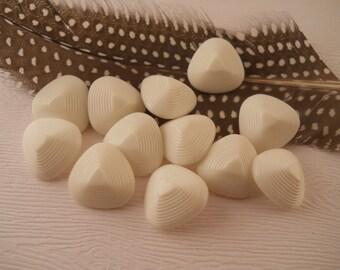 BUTTONS: White ridged buttons.  Triangular shape, 3/4 inch size.  One dozen.
