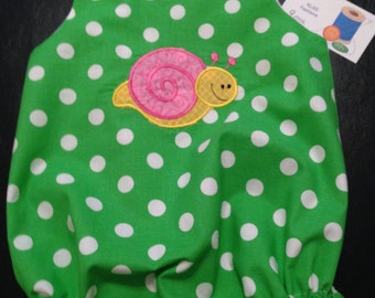 Infant girls bubble suit with applique.