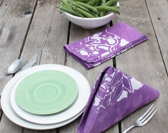 pair of dinner napkins. pale purple trellis batik