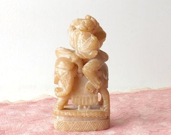 Vintage Carved Chinese Yellow Jade or Soapstone Man Riding Elephant