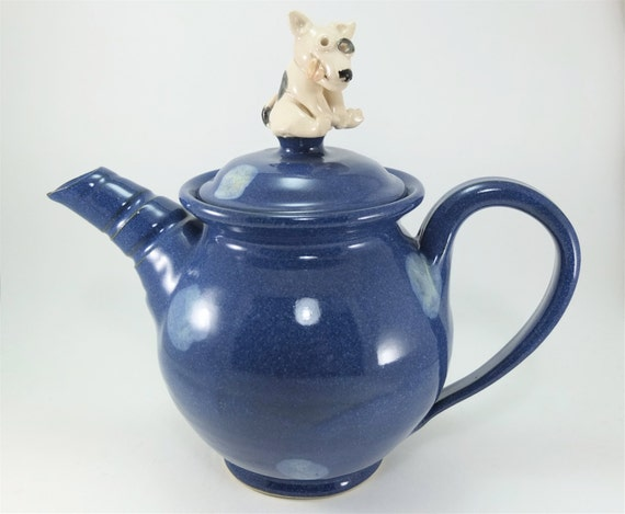 blue teapot with a dog