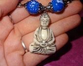 Wire buddha necklace with pink and blue accents