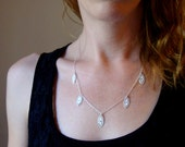 Womens Delicate lace pod necklace in sterling silver