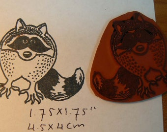 Raccoon rubber stamp.