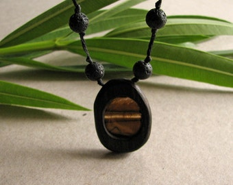 Organic Natural Tiger Eye Gem Encapsulated In Ebony Wood Hand Carved Pendant With Natural Lava Beads by Tanja Sova