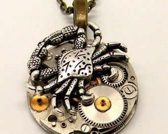 Steampunk watch with crab pendant necklace. Steampunk jewelry.