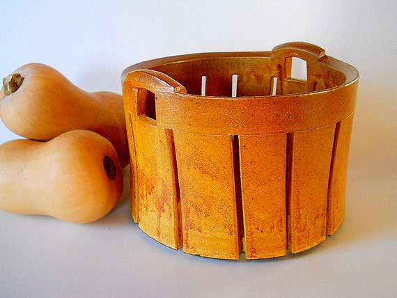 Basket with handles for fruit, bread or storage.