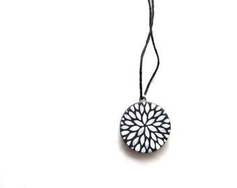 petite pendant - petal burst in black and white