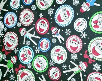 "Christmas Sock Monkey Cotton Fabric 44"" wide sold by 1/2 yard"