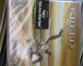 "Creed Human Clay Sealed CD with ""Higher"" and ""With Arms wide Open"" sticker New"