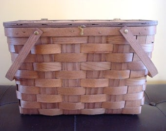 Very nice woven picnic basket with swing handles and hinged lid- Basketville, Vt.