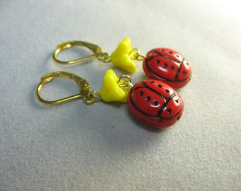 ladybug earrings ... red glass lady bug earrings with bright yellow flowers