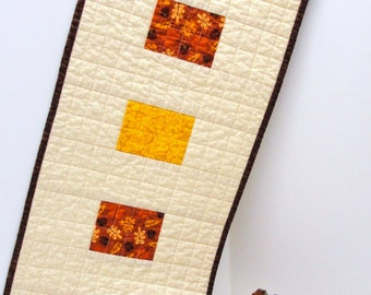 """Thanksgiving table runner- quilted- with rust, mustard, brown and brick red on beige  """"Autumn"""" with acorns, leaves, sunflowers READY TO SHIP"""