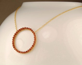 Garnet necklace, gold circle necklace, eternity necklace, handmade, wire wrapped jewelry, January birthstone