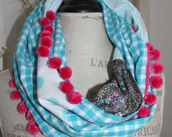 whimsical mixed pattern with pom pom infinity scarf