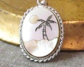 Vintage palm tree on a moonlit beach pendant. Scrimshaw on mother of pearl.