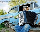 57 Chevy Blues, large original photograph of white boxer dog wearing clothes and playing accordion next to 1957 Chevy