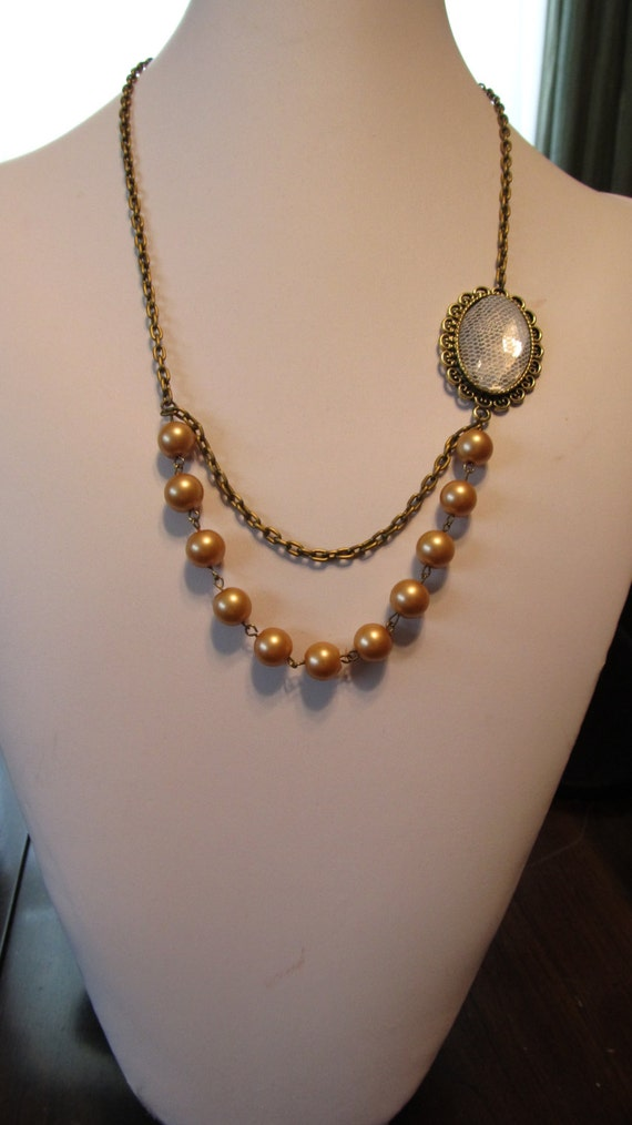 22 inch beige pearl necklace