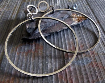 Rustic sterling silver large hoop earring.  Post style dangling 2 inch hoops.  Oxidized & rough brushed texture. Light and dark. Flashy.