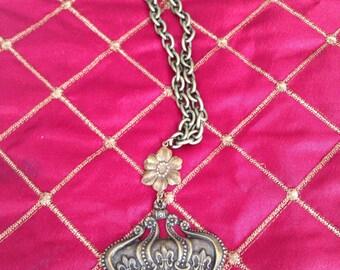 A regal antique crown  necklace.