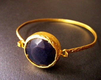Thick 18 gold plated bangle, bracelet with dark purple/black Gemstone