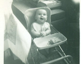 Happy Baby Sitting in High Chair Ready To Eat Wearing Bib Vintage 1950s Black and White Photo Photograph