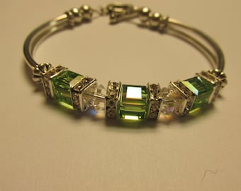 Peridot in color and its for August Birthstone.