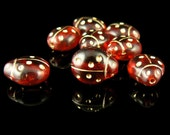 13mm x 11mm transparent red glass Preciosa ladybug shaped beads with gold details, 6 pcs.