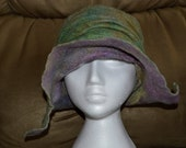 Styleable hand dyed merino wool warm winter hat, brim up or down in purples and greens, blues and rust tones, hand made