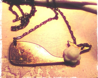 Moby Dick with an ivory flower pendant