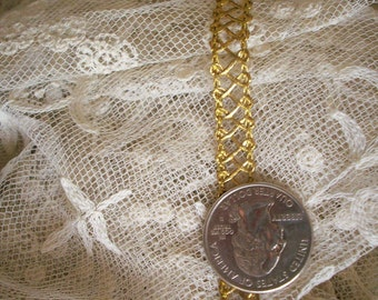 1 yard of an antique french gold metal trim, more avail.