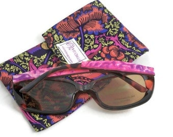 Colorful sunglasses with pink side arms and handmade case