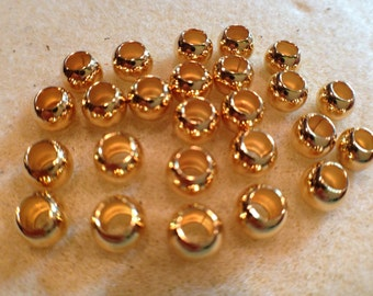 6mm smooth round bead with 3mm hole. Gold plated, 25 pk NICKEL FREE