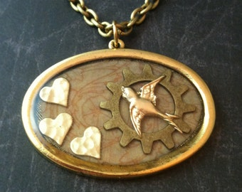 Oval Gold Tone Heart, Gear and Bird Steampunk Necklace