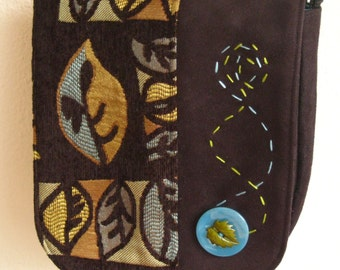 handbag with leaf pattern in black, greens and turquiose